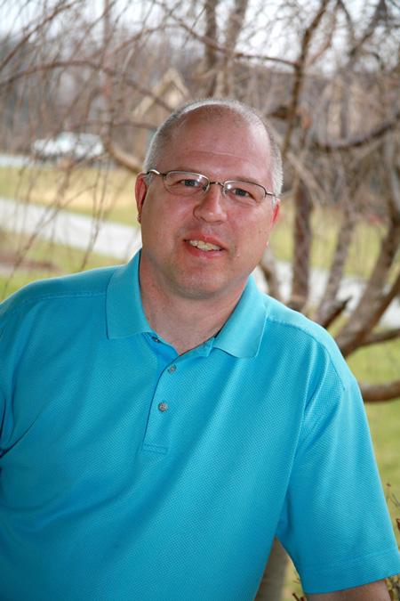 Brian Boetel portrait in front of tree